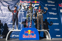 Joni Wiman, Ken Block, and Bucky Lasek celebrate on the podium after winning the Supercars class