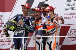 Podium: race winner Marc Marquez, second place Valentino Rossi, third place Jorge Lorenzo