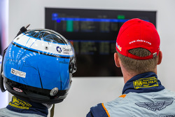 Darren Turner and Stefan Mücke watch the final moments of qualifying
