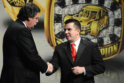 NASCAR Southern Modified Tour champion Andy Seuss gets a championship ring from NASCAR president Mike Helton