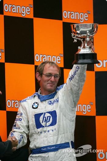 Podium: Williams-BMW's Dickie Stanford accepts constructors trophy