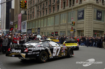 Kurt Busch leads the parade of the top ten NASCAR finishers through the streets of New York City