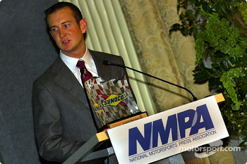 Kurt Busch hold the Diamond Performance award from Sunoco at the NMPA breakfast