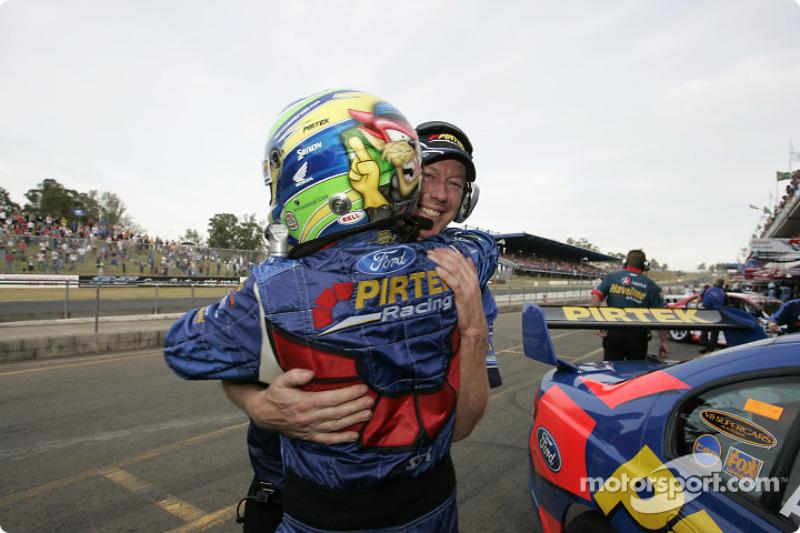 Australian V8 Supercar Series 2004 champion Marcos Ambrose celebrates