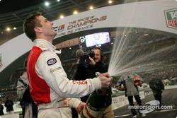 Sébastien Loeb sprays champagne