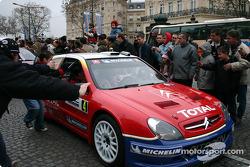 Parade on Champs-Elysées: WRC champion Sébastien Loeb drives his Citroën Xsara WRC