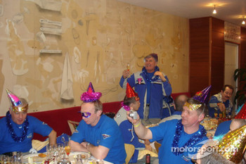 Kamaz-Master team members celebrate before the start