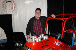 Butch Wilkerson, three-time Sprint champion at Lawrenceberg Speedway, poses with the #1 replicar.