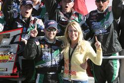 Victory lane: race winner Tony Stewart celebrates with DeLana Harvick