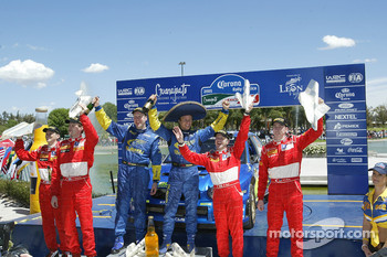 Podium: winners Petter Solberg and Phil Mills, with Marcus Gronholm and Timo Rautiainen, and Markko Martin and Michael Park
