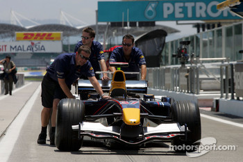 Red Bull team members push car