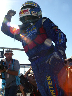 Marcos Ambrose salutes the crowd