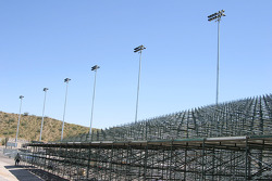 Temporary bleachers in construction on the backstretch