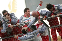 Toyota team members celebrate second place of Jarno Trulli