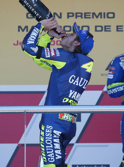 Podium: champagne for race winner Valentino Rossi celebrates