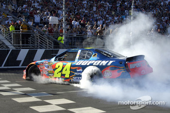 Race winner Jeff Gordon smokes the tires