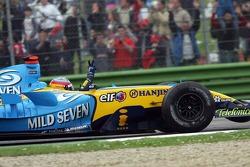 Race winner Fernando Alonso celebrates