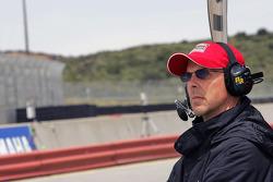 Scott Pruett watches qualifying