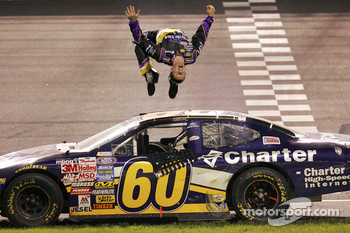 Race winner Carl Edwards performs a backflip
