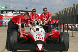Ryan Briscoe's team push the car out to qualify