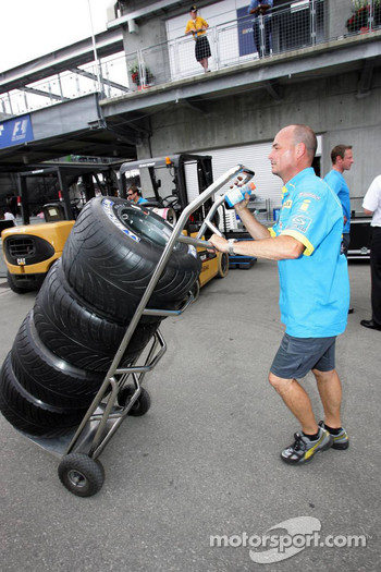 Renault team members pack up during the race