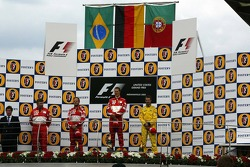 Podium: race winner Michael Schumacher with Rubens Barrichello and Tiago Monteiro