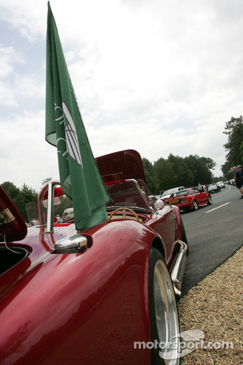 Fans meet with their sports cars at Indianapolis and Arnage corners on Friday
