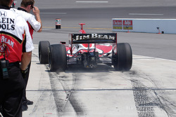 Dan Wheldon peels out of the pits