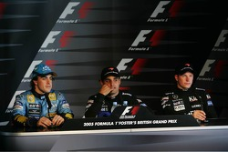 Press conference: race winner Juan Pablo Montoya with Fernando Alonso and Kimi Raikkonen