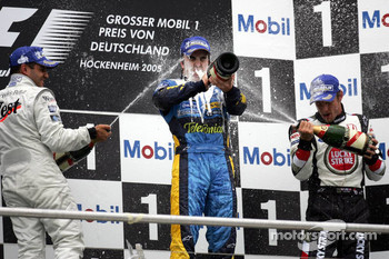 Podium: champagne for Fernando Alonso, Juan Pablo Montoya and Jenson Button