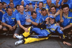 Race winner Fernando Alonso celebrates with Renault F1 team members
