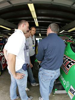 Bobby Labonte discusses with Grand-Am drivers Fabrizio Gollin and Matteo Bobbi