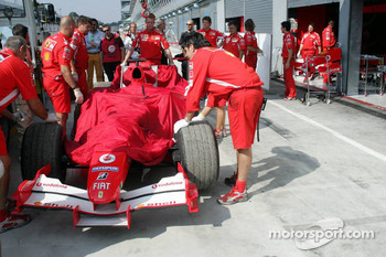 The Ferrari of Felipe Massa back in the garage after having stopped on the track