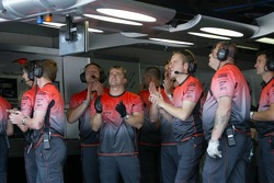 McLaren team members celebrate 1-2 fastest laps