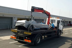 The car of Heikki Kovalainen taken back to the pits after engine problems