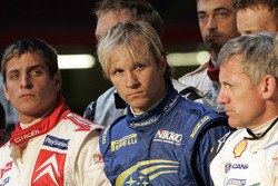Sad celebrations: rally winner Petter Solberg and fellow drivers and codrivers pay tribute to Michael Park