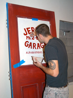 Painting of false window for Jerry's Garage office door
