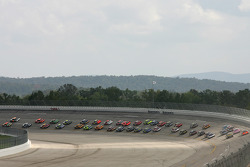 Elliott Sadler and Dale Jarrett lead the field into turn 1