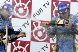 Podium: champagne for Giancarlo Fisichella and Fernando Alonso
