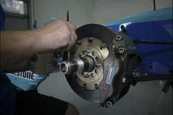 A crew member prepares the cars