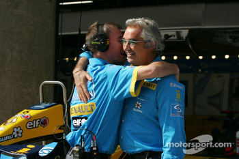 Flavio Briatore celebrates Fernando Alonso's pole position
