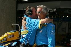 Flavio Briatore celebrates Fernando Alonso's pole position
