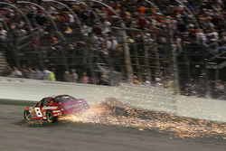 Dale Earnhardt Jr. cuts a tire and hits the wall