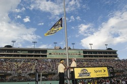 The 2004 championship flag of Kurt Busch is brought down