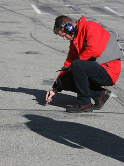 A Bridgestone engineer checks temperature