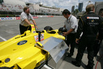 Champ Car 2-seater experience: a guest is about to climb aboard