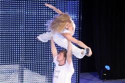 Models doing acrobatics on stage