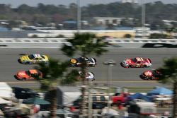 Cars at speed in turn 3