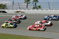 Three-wide in turn 4