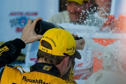 Matt Kenseth sprays his team with champagne